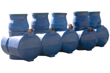 Blue plastic septic tanks stand in a row. Isolated background, a large barrel of sewage. Five cylindrical containers. Stock fotó