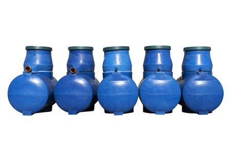 Blue plastic septic tanks are standing. Five cylindrical containers in a row. Isolated white background, a large barrel of sewage. Stock fotó