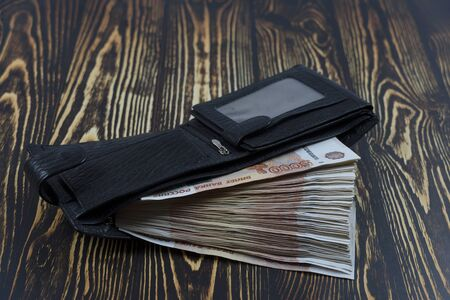 Five thousandth Russian rubles in the wallet. Money bundle salary. Wallet with money in large bills.