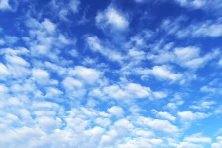A huge blue sky with beautiful white clouds. Background with sky in the afternoon for copy.