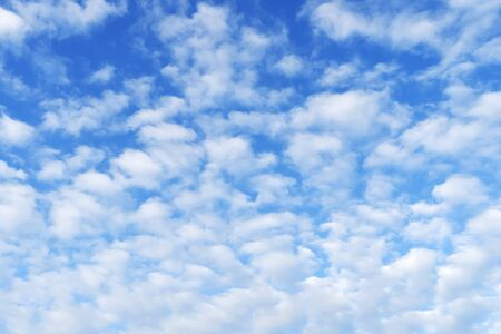 Beautiful blue sky with white heap clouds. Day summer sunny day.