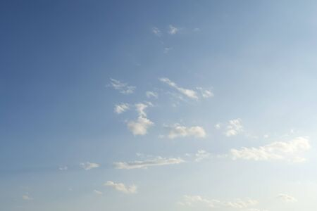 Background blue sky with white clouds. Bright sunny day, blue sky and clouds. 写真素材 - 133344172