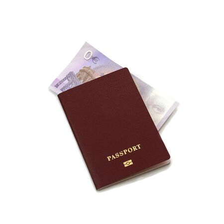 International red passport with a zero euro banknote. The concept of a free vacation or tourism. Free passport. 写真素材
