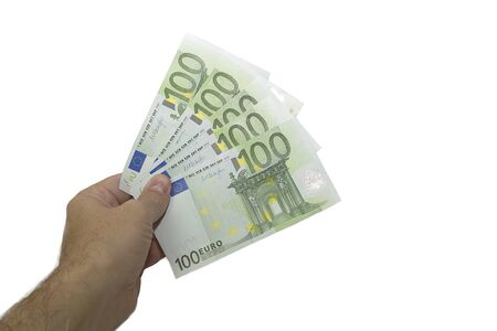 Hand holds euro currency in a fan. A pack of money in denominations of 100 euros. Isolated on a white background.