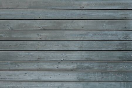 Texture blue wooden background. Background from several natural horizontal boards of blue color. The old painted wall. 写真素材 - 134446969