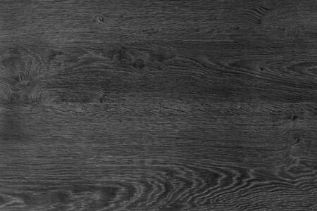 Black wood background. The texture of natural wood is dark color, flooring. The design board is empty.