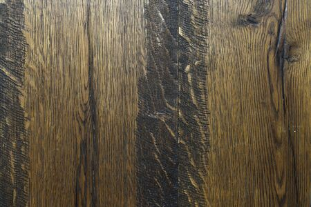 Background from black and yellow wooden vertical boards close-up. Scratched wooden boards, texture for design. Old used natural wood. 写真素材