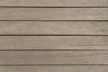 Background of wooden horizontal panels of new boards. Wooden light brown boards, texture for design. Natural wood.
