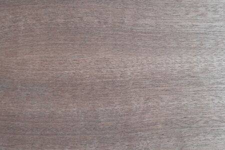 Light brown reddish wooden laminate background. Flooring: smooth wood, walnut, ash, beech, oak, pear. Veneer coating for panels.