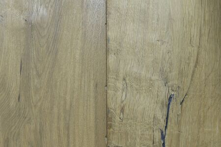 Background from yellow wooden vertical boards close-up. Wooden flooring boards, texture for design. Scratched natural wood.