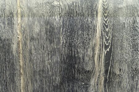 Background from black and yellow wooden vertical boards close-up. Wooden boards, texture for design. New natural wood. 写真素材