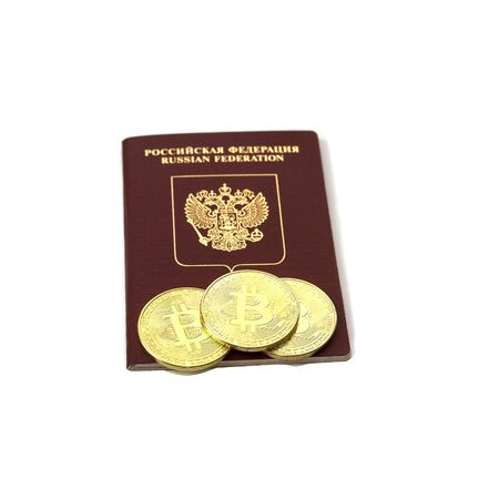 Russian passport with gold coins bitcoins. The concept of immigration, violation of the law, official recognition of cryptocurrency in Russia. Isolated on a white background.