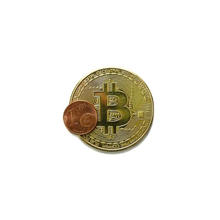 Bitcoin cryptocurrency gold coin with one euro cent coin. Bitcoin to euro cent rate depreciation concept. Isolated on a white background.