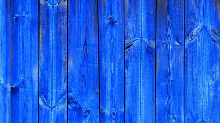 Background blue textured modern trend color, wooden planks vertical. Old ragged wooden blue boards, texture for design.