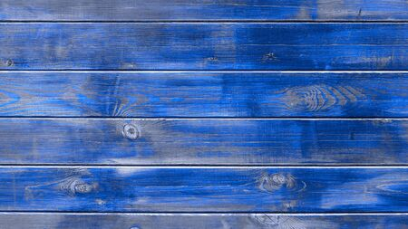 Background blue texture modern trendy, wooden planks horizontal. Old wooden blue boards, texture for design.