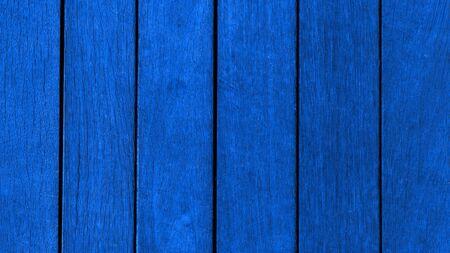 Background blue 2020 modern trend, wooden texture from boards horizontal. Wooden blue boards, texture for design.