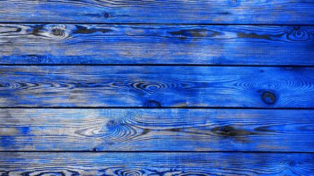 Background blue textural modern trend color, wooden planks horizontal. Old ragged wooden blue boards, texture for design.