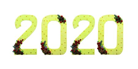 Golden numbers 2020 happy new year on a white isolated background. Designer background for decoration. With Christmas tree branches, red balls, a beautiful Christmas decoration.
