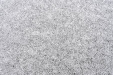 White snow background for designers. White snow closeup snowflakes. Crystals of snow on the ground, winter came cold.