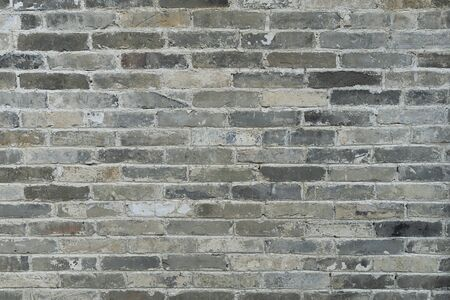 Gray brick burned wall. Background of bricks for use texture in design. Old brick and cement texture.