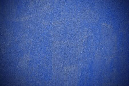 Blue concrete wall with a textured surface with brush marks. Modern blue trending wall color. Blue surface for design background texture. 写真素材