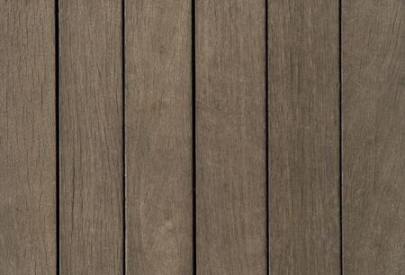 Design background made of wood. Vertical brown planks. New blank of wooden texture for design. 写真素材