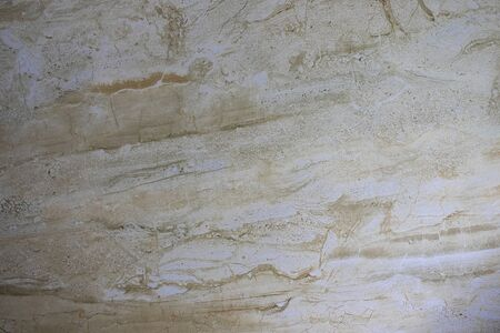 Texture for designers natural marble stone. Background of yellow glossy stone. Abstract stone concept with stripes.