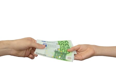 An adult pays a child paper money. The concept of inheritance transfer or payment for minor labor. European currency in denominations of one hundred euros. 100