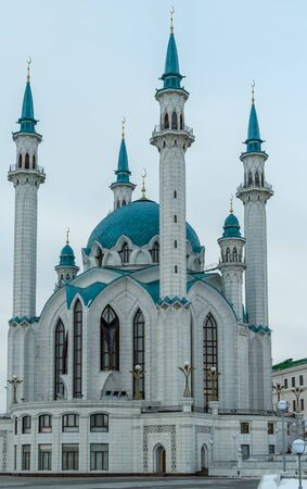 White mosque with blue domes during the day, blue sky. Vertical view. Kazan Kremlin, the main cathedral juma mosque Kul-Sharif.