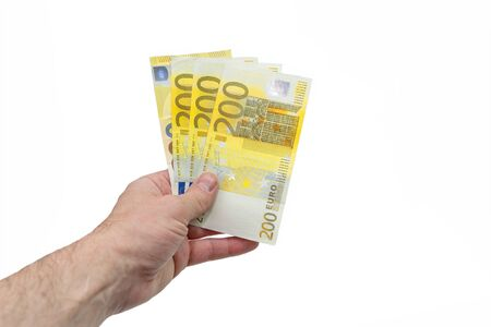 A fan of 200 two hundred euros. The hand of a European man holds a fan of European money. Isolated white background. Close-up.