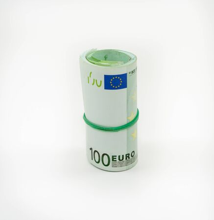 Banknotes one hundred 100 euros in a roll with an elastic band. European currency to save. Close-up, white background. The concept of the safety of deposits and money. 版權商用圖片