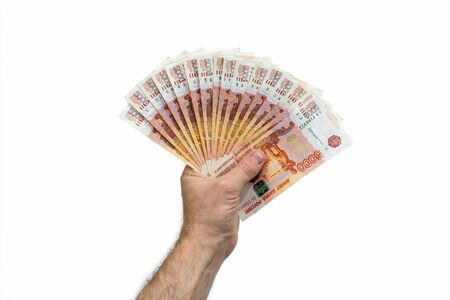 A fan of 5,000 five thousand rubles. The hand of a European man holds a fan of Russian money. Isolated white background. Close-up.
