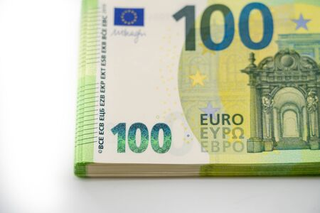 A pack of notes 100 hundred euros. European currency. On white background. Part of a batch of money. Blank for designers. 写真素材