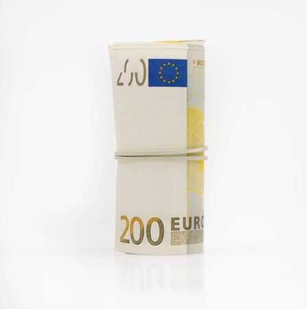 Banknotes two hundred 200 euros in a roll with an elastic band. European currency to save. Close-up, white background. The concept of the safety of deposits and money.