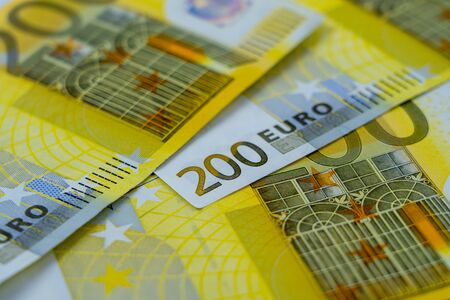 Banknotes of two hundred and 200 euros are scattered in a chaotic manner. European currency blank for design, background. Side view. 写真素材