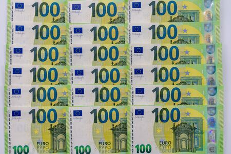 Banknotes of 100 hundred euros lie exactly in three rows. European currency, close-up. Blank for design, background. 写真素材