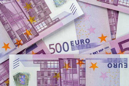 Banknotes of five hundred and 500 euros are scattered in a chaotic manner. European currency lies on the table. Blank for design, background. View from above. 写真素材