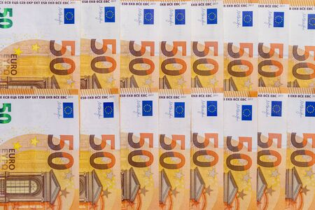 Banknotes of 50 fifty euros lie exactly in two rows. European currency, close-up. Blank for design, background. The horizontal layout. 写真素材