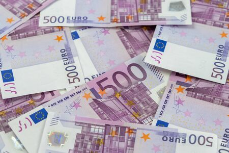 Banknotes of five hundred and 500 euros are scattered in a chaotic manner. European currency blank for design, background. Side view.