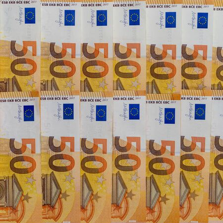 Banknotes of 50 fifty euros lie exactly in two rows. European currency, close-up. Blank for design, background. Vertical layout. 写真素材