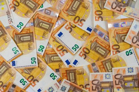 Banknotes of 50 fifty euros are scattered in a chaotic manner. European currency blank for design, background. View from above. 写真素材