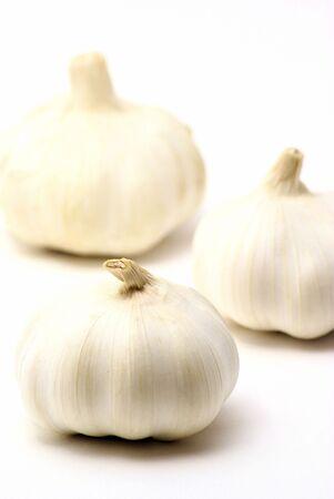 Three garlic bulbs. photo