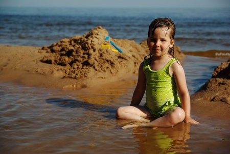children sandcastle: Child playing at the beach Stock Photo