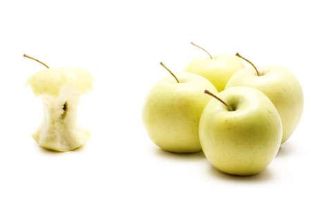 eaten: One apple core vs four whole apples Stock Photo