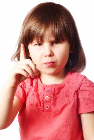 little finger: Little girl holding index finger up  Stock Photo