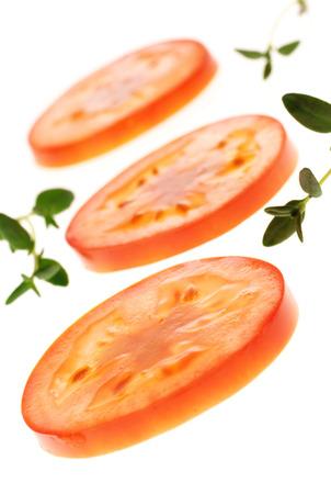 nutricion: Three tomato slices with herbs Stock Photo