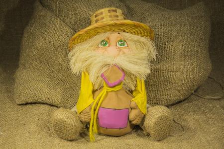 troll dolls: Toy House spirit in a straw hat keeps bag