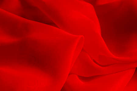 folds: Shiny red silky fabric folds background texture Stock Photo