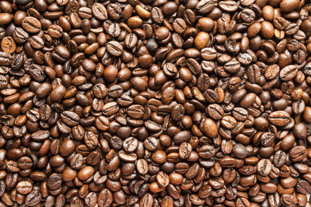large bean: coffee beans roasted Brown background