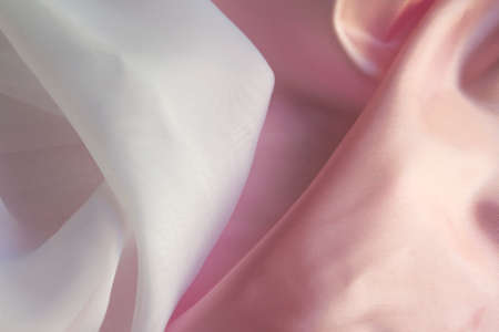 folds: Shiny Pink and white silky fabric folds background texture